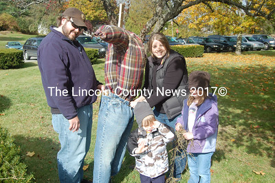The Mains of Wiscasset enjoy making their own scarecrow for sale as a Wiscasset Community Center fundraiser Saturday. From left, parents Chris and Andrea Main and children Cameron and Kaitlyn. (Greg Foster photo)