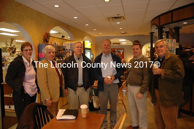 State and local officials huddle in Damariscotta's Maine Coast Book Shop and Cafe to to discuss local roads. Pictured (from left to right) Rhonda M. Fletcher, Dick McLean, DOT commissioner David Cole, Rep. Jon McKane, Greg Zinser and Ron Grenier. (Joe Gelarden photo)