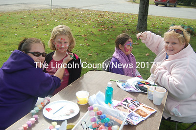 Face painting proved a popular thing to do Saturday during the scarecrow making fundraiser in Wiscasset. From left, Devin Fisk, Eva Reed, August Moore, and Janet Bickford. (Greg Foster photo)
