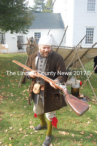 Newcastle resident Mark Daiute displays a musket with metal pieces forged from parts of the Hesper and Luther Little ships formerly located in Wiscasset harbor. (Greg Foster photo)