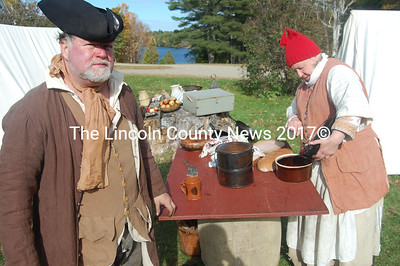 Cranberry sauce to go with the turkey Terri Palmer, right, of Brunswick prepares makes Tom Girard of Washington anxious for dinner. (Greg Foster photo)