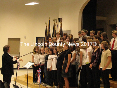"The Medomak Middle School chorus sang ""America the Beautiful"" and ""God Bless the USA"" at their Veterans Day assembly on Tuesday. The school band also played ""The Star Spangled Banner."" (J Maguire photo)"