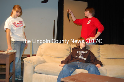 "Wiscasset High School students practice for the school's production of ""The Murder Room"" mystery/comedy for Fri., Nov. 20 and Sat., Nov. 21. From left, Alyssa Urqhart, Kyle Shute (on couch), and  Shane Cushing. (Greg Foster photo)"