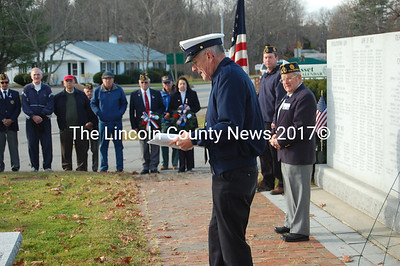 Rev. Wally Staples addresses the Wiscasset observance of Veterans' Day in front of the Honor Roll. (Greg Foster photo)