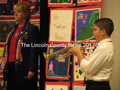 "Medomak Middle School students Ethan Morin and Cyril Miller played ""Taps"" following the story of Taps read by ceremony organizer Nancy Durgin (left) at the Medomak Middle School Veterans Day Assembly on Nov. 10. (J Maguire photo)"