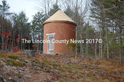 Wiscasset's historic Powder House, built for the War of 1812, now is plainly visible to passersby on Churchill Street because of trees cut in preparation for a housing development.  (Greg Foster photo)