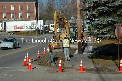 Once again, MDOT workers dig up Rt. 1 B in front of Newcastle's historic Taniscot Fire Station and town office building. Will they find the source of the water that has been underimining the pavement this time? Stay tuned. (Joe Gelarden photo)