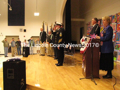 Veterans stood at attention during the Veterans Day Assembly at Medomak Middle School on Tuesday. Led by drama teacher Nancy Durgin, the ceremony required the participation of many students who sang, praised veterans, played music, read poetry and read veteran biographies. (J Maguire photo)