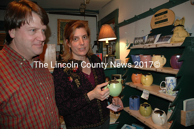 Wells Hodious and Elizabeth Potter check out the tea pots at the Granite Hall Store's 2009 closing day bargain sale on the day before Christmas. (Joe Gelarden photo)