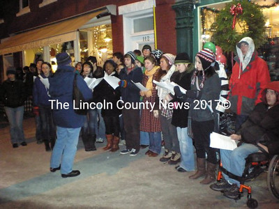 Getting into the holiday spirit, and encouraging passers by to do the same, are Lincolnaire carolers from Lincoln Academy. (S. Olin photo)