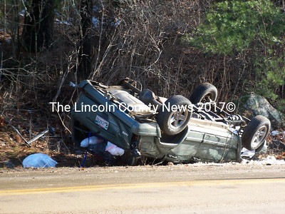 Mohamed Farag's Jeep Cherokee is upside down on the side of So. Clary Road in Jefferson Monday morning. Farag was alone in the car and no other vehicles were involved. Farag got out of the car on his own and refused medical treatment. (Baldwin/Toy photo)