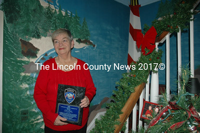 Debbie Mullin shows off the award she received from the Lincoln County Sheriff. She recently was recognized by President Barack Obama for her work with the Lincoln County TRIAD. (Joe Gelarden photo)