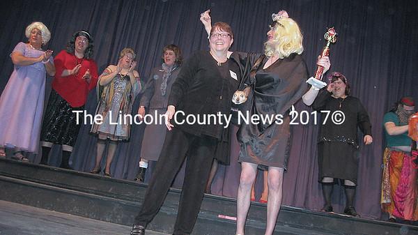 Mary Trescott awards Miss Brit (Patrick Leeman), the trophy as overall winner.