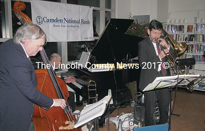 A jazz trio led by Barney Balch on trombone played sweet compilations for a huge crowd packed into the Skidompha Library Saturday night during the Healthy Kids! Chocolate Fest fundraiser. (J Maguire photo)