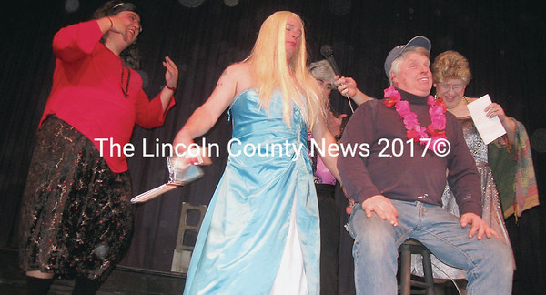 Sheriff Sisters, winners of the coveted Most Talented award, cavort with audience member Nick Buck.
