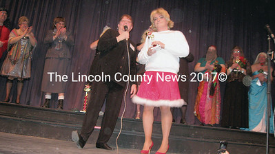 Krissy Kringle (Steve McDermott), accepts her trophy as Drama Queen from Mary Trescot.