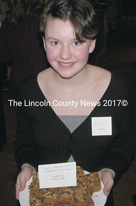 Autumn Beaudoin, a home schooled student from Alna, joined other students in passing around sweet delicacies at the Healthy Kids! Chocolate Fest at the Skidompha Public Library in Damariscotta Saturday night. (J Maguire photo)