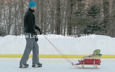 Wiscasset resident, Sumner McKane and one year old daughter, Piper demonstrate that all ages can have fun on the ice. (photo by Tammy L.R. Meserve)