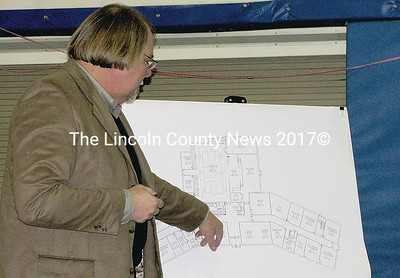 Architect Robert Tillotson shows concept design of new school building project proposed for Jefferson during a regular school board meeting Wednesday night.
