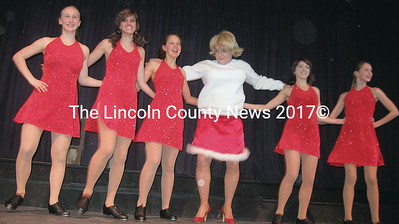 Drama Queen Krissy Kringle (Steve McDermott) joins the Renys Rockettes chorus line for some high steppin'.