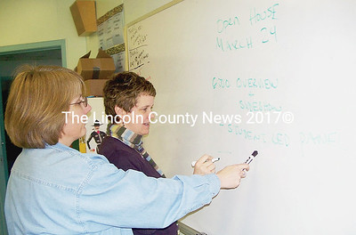 Wiscassset HIgh School teachers Jean Phillips, left and Jenn Williams plan their school's open house Tues., March 24 to give parents and students in the new Sheepscot Valley Regional School Unit a chance to learn about its assets. (Greg Foster photo)