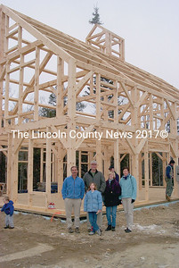 The photo shows the post and beam headquarters for Anderson Farms when it was under construction a few years ago. Owner Dennis Anderson is pictured in group in center (with cap). (Greg Foster file photo)