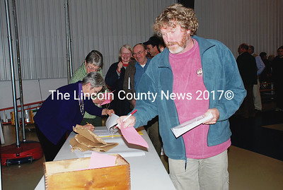 South Bristol resident Peter Erskine casts his vote on Article 41 at the annual town meeting March 10. (E. Elliott photo)