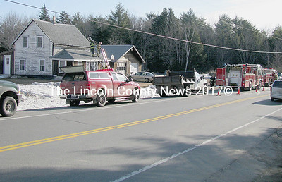 Local fire departments from Jefferson, Windsor, Whitefield and Somerville responded to a call of a chimney fire at 946 Rockland Rd. (Rt. 17) in Somerville, across the road from the Somerville Fire Station on Friday, March 20 at approximately 8:20 a.m.  Whitefield and Windsor fire turned back to their stations, as the fire did not spread to the rest of the structure. Somerville Fire Chief Mike Dostie said while he thanks all mutual aid departments, they were able to put the fire out with a dry chemical extinguisher and firefighters worked on cleaning the chimney out from the roof. Firefighters dispersed the scene at 9:32, Dostie said. (J Maguire photo)