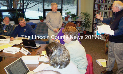 Wiscasset budget commiittee chairman Steve Mehrl, right, discusses the proposed Wiscasset school budget with Sheepscot Valley Regional School Unit finance committee chairman Gerry Nault, middle. From left, finance committee members Richard DeVries and Blake Brown, Nault, and Mehrl. (Greg Foster photo)