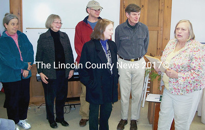 First Selectman Billie Willard, right, commends Doreen Conboy for her efforts for Alna, which chose to dedicate its town report to her. With her are members of the Committee for Alna History who worked with her. From left, Mary McPherson, Mary Fossel, Miles Jordan, Rep. Les Fossel, and Willard. (Greg Foster photo)
