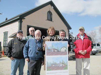 Architect Anne Callender holds her design of the new Dresden fire station, the groundwork of which has already started. She is accompanied by Dresden Fire Chief Jerald Lilly, building committee member Phil Johnson, selectmen John Auttum, general contractor Ken LaJoie of LaJoie Brothers, Inc. and second selectman Jamie Rae. Pictured behind the group is the Pownalborough Hall, presently being used as the fire station and to be restored for the town hall. (J Maguire photo)