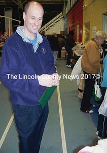 CLC YMCA Executive Director Craig Wilson has his money bag out; he was wheelin' and dealin'. (Kim Fletcher photo)