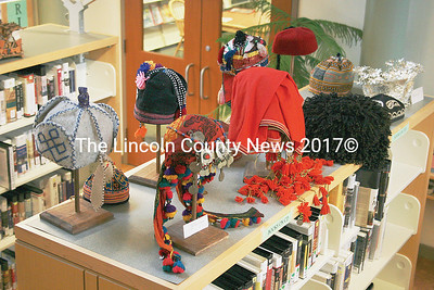 A grouping of cultural headgear on display at the Skidompha Library. (Janine Parziale photo)
