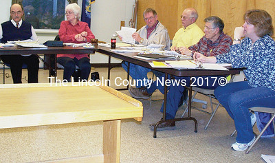 Wiscasset selectmen try to answer questions and comment on warrant figures for June 9 ballot. From left, Town Manager Arthur Faucher, secretary Jackie Lowell, Selectmen Chairman David Nichols, Jr., Selectman Bob Fairfield, Sr., Selectman Bill Curtis, and Selectman Nicole Viele. (Greg Foster photo)