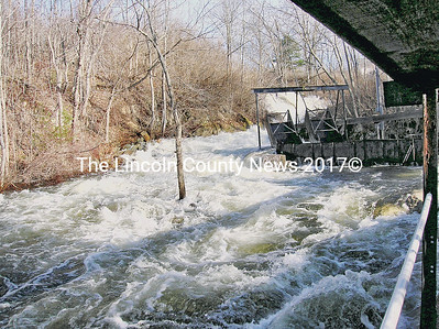 Springtime whitewater boils down past the Damariscotta Mills fish ladder.  (jg photo)