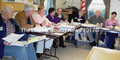Wiscasset budget committee members chew on warrant article figures. From left, George Greene, Greg Shea, Judy Colby, Pam Dunning, Richard Handson, Steve Mehrl, and Sherry Dunbar. (Greg Foster photo)