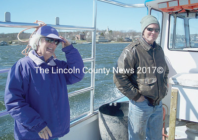 Edgecomb residents Bobbie, left and Scott Carleton join the Fairfields on their new boat's maiden voyage around the harbor to share the joy of the experience. (Greg Foster photo)