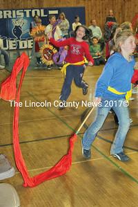 Brandishing long cloth handkerchiefs BCS students dash across the gymnasium. (Janine Parziale photo)