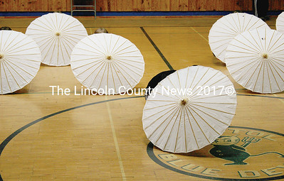 Behind their Chinese parasols, the small BCS girls quietly hide from view. (Janine Parziale photo)