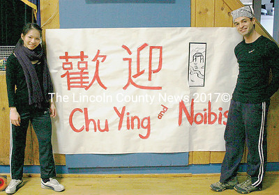 Diversity Week choreographers Chu Ying Ku and Noibis Licea stand next to the banner display of their names. (Janine Parziale photo)