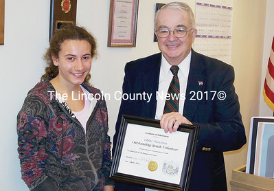 Commissioner Chairman Bill Blodgett, right, presents Lincoln Academy junior Chloe Maxmin with a special commendation on behalf of Lincoln County for outstanding youth volunteer service. (Greg Foster photo)