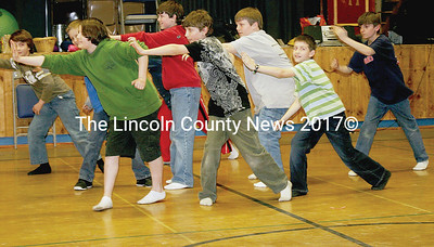 Moving as a unit, these BCS boys lunge to the side as they perform for this year's Diversity Week rehearsal. (Photo Janine Parziale).