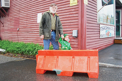 "Alan McKinnon, the owner of Naragansett Leathers, and his grand daughter Scarlet Stone say making the west west entrance to the Damrariscotta harborside parking lot one way ""IN"" will help traffic safety. n(Joe Gelarden photo)"