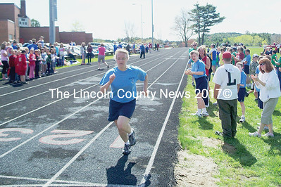 Boothbay runner Brenda LaConte heads for the finish line in one of the Special Olympics regional events Friday at Wiscasset High School. (Greg Foster photo)