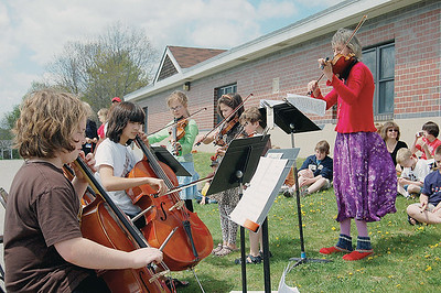 Presenting Katie (Newell) and the Fiddleheads, the string players from the Great Salt Bay School. The group entertained the crowd at opening of a solar greenhouse donated by Bob Hardina. (Joe Gelarden Photo)