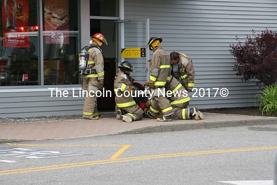 Damariscotta and Newcastle firefighters ventilate McDonald's in Damariscotta after a fryolator overheated June 11. (J Maguire photo)