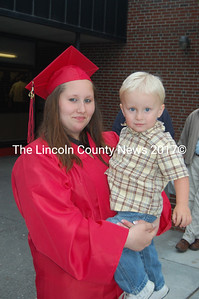Graduating senior Bethany Dow holds her cousin, Tucker Graffam, 2, before Wiscasset's commencement. (Greg Foster photo)
