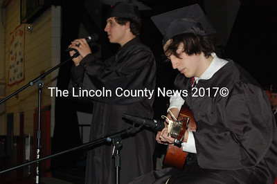 Singer Lincoln Hull and guitarist Logan Shifflett entertain their classmates and audience for Wiscasset's graduation. (Greg Foster photo)