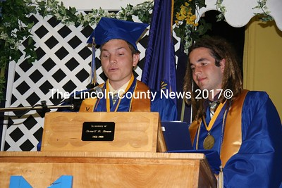 Valedictorian Micah Ludwig and Salutatorian Brian Sweeney give a combined address to fellow Medomak Valley High School classmates during the June 10 graduation ceremony. (J Maguire photo)