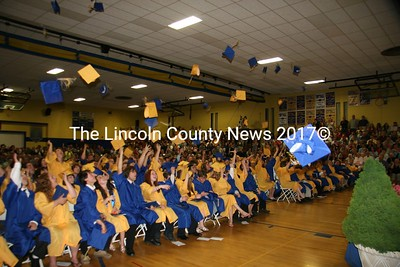Memomak Valley High School graduates cheer and toss mortorboard hats in a final gesture of farewell to their high school careers. (J Maguire photo)